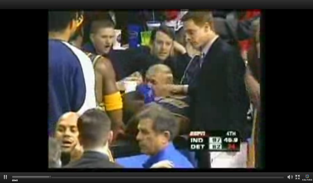 Ron Artest gets hit by a cup right before malice.